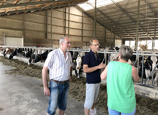 With international visitors on a farm visit